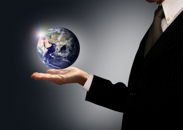 Businessman holding Earth globe - Globalization concept